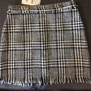 Zara checked skirt with two gold buttons